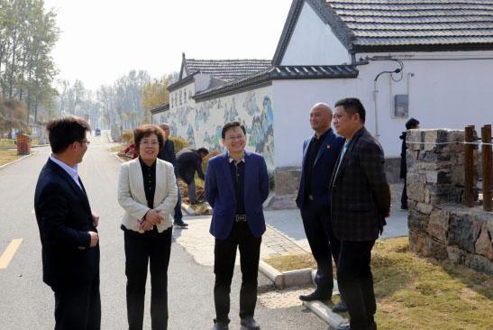 邳州市国土资源局代表团专题考察睢宁县改善农民住